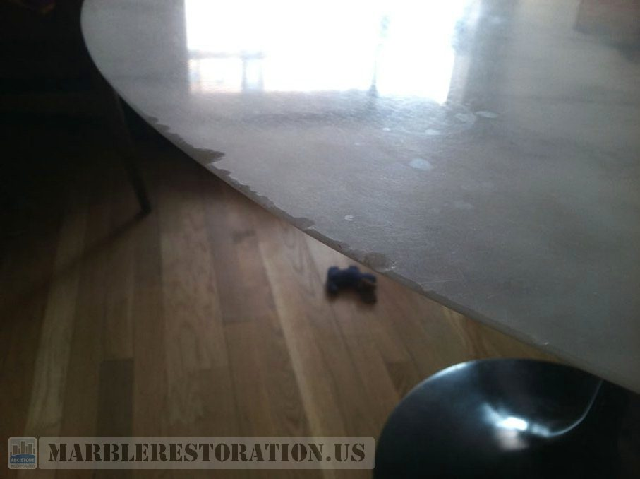 Chips on marble table. Repair