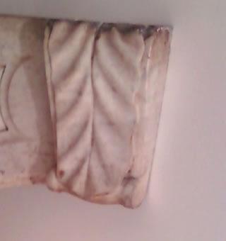 Fireplace Keystone Before Restoration
