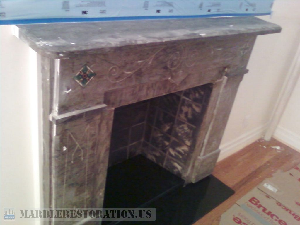 Dark Marble Fireplace Before Cleaning