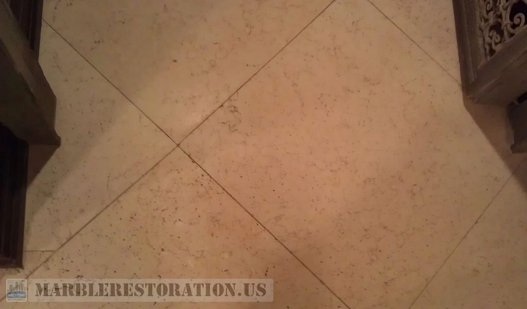 Limestone Tiles under Door Frame. Cracks Repair Service