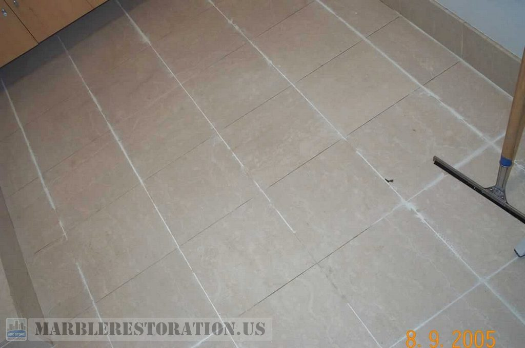 Removing Old Grout from Tiled Bathroom Floor