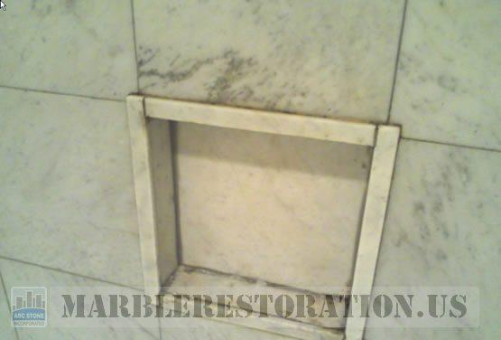 Built-in Shower Shelf. Yellowing