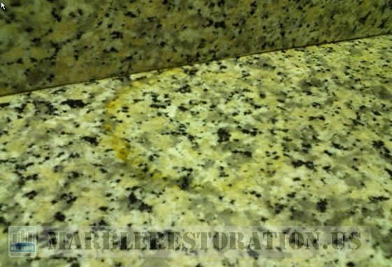 Rust Stain on Counter Top. Golden Granite