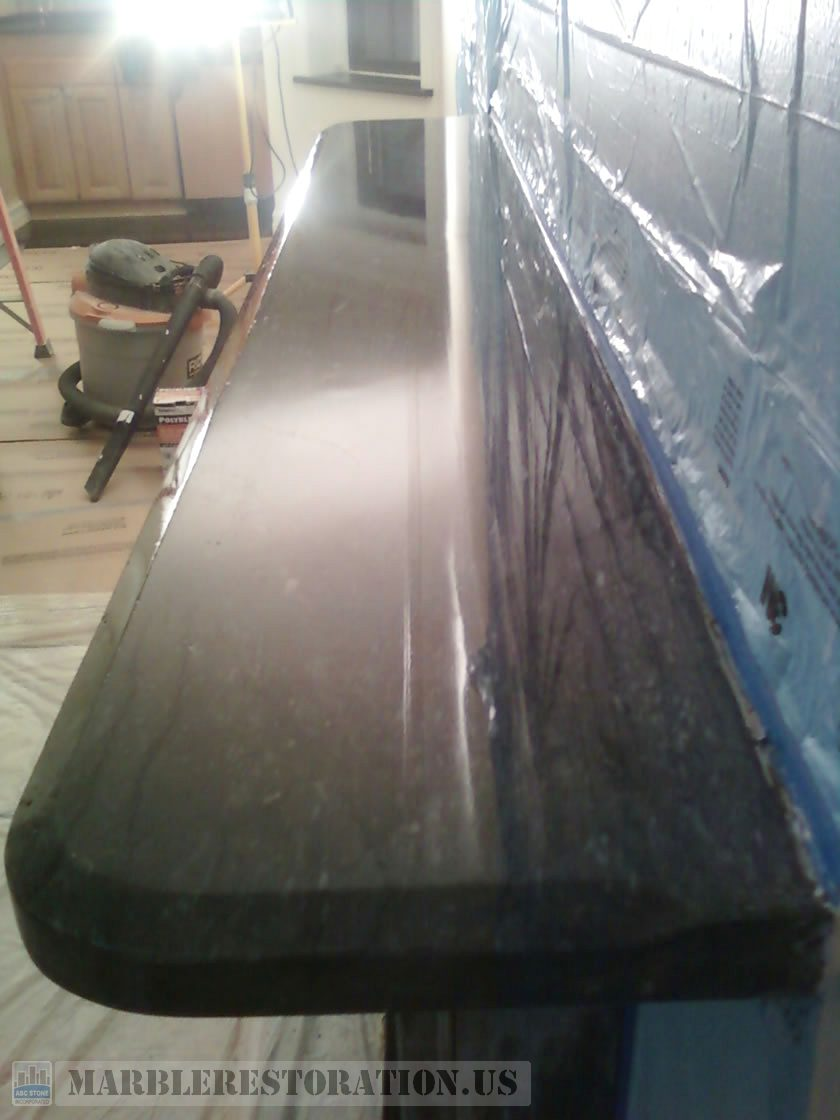 Beveled Top Slab on Fireplace. Polishing and Sealing