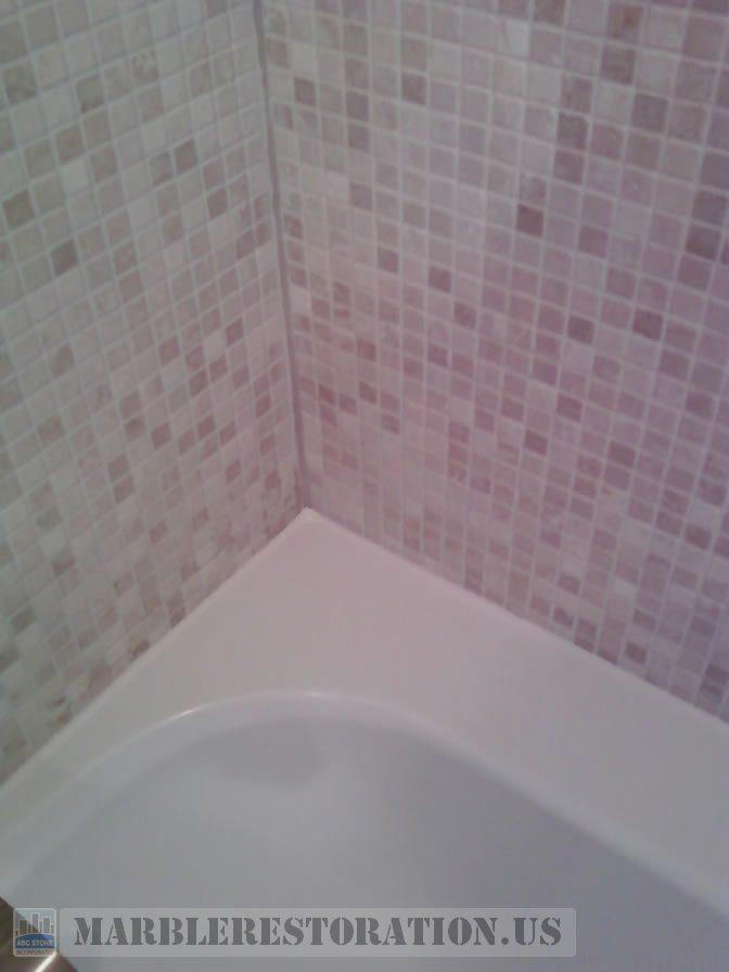Two colors recaulking on acrylic tub and mosaic wall